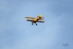 D8504150-Bi-plane-flying-overhead